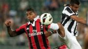 A.C. Milan player Ambrosini (SX) figths