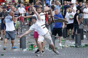 epaselect epa05355757 An England fan throws a chair during clashes bewteen English and Russian supporters at the Old Port of Marseille, France, 10 June 2016, on the eve of the UEFA EURO 2016 group B preliminary round match between England and Russia. The UEFA EURO 2016 soccer championship runs from 10 June to 10 July 2016 in France.  EPA/GUILLAUME HORCAJUELO